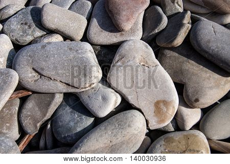 sea pebbles as a background close up.