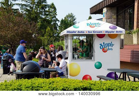 BROOKFIELD, ILLINOIS / UNITED STATES - MAY 21, 2016: People purchase Dippin' Dots ice cream from a concession stand in the Brookfield Zoo.