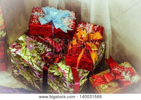 Christmas and New Year gifts. Holiday decorative boxes. Photos with vignetting effect.