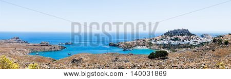 Panoramic view of Lindos bay, the village and the Akropolis of Lindos in Rhodes island, Greece