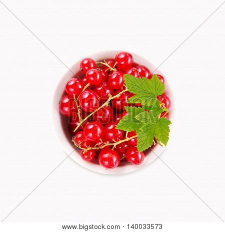Red currants in the bowl isolated on white background.
