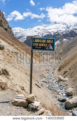 Landslide prone area sign on Annapurna circuit trek, Nepal