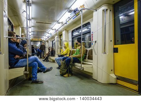 MOSCOW, RUSSIA - APRIL 4, 2015: Commuters in subway train in Moscow, Russia. Moscow subway (Metro) offers convenient transportation alternative to traffic jammed surface roads