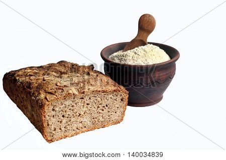 wholegrain bread and wholegrain wheat flour with a wooden spoon in a clay bowl