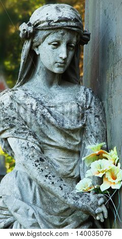 Statue of woman on tomb as a symbol of depression pain and sorrow (Lychakiv cemeteries Lviv Ukraine)