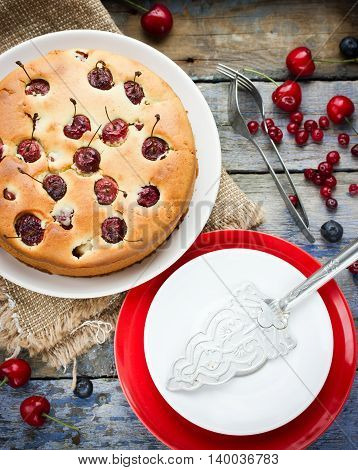 Delicious homemade cherry pie or sponge cake top view