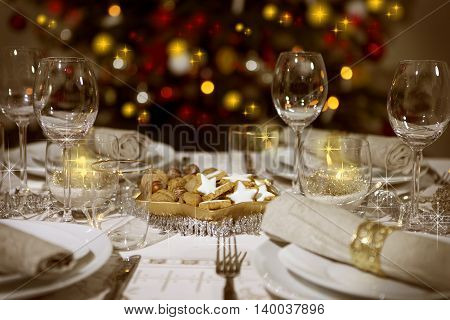 Festive table with christmas tree in the background