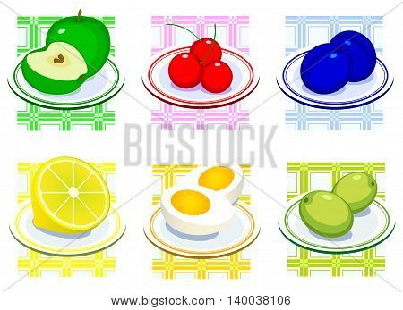 Set of fruits on a plate on the kitchen tablecloth