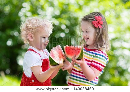 Kids Eating Watermelon In The Garden