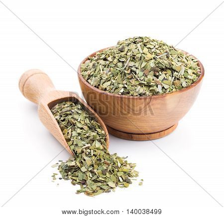 Mate tea in a wooden bowl isolated on white background