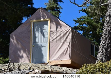 Modern and rustic tent cabin at a rural pine forest in Mt Baldy, CA