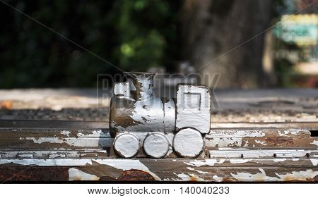 a little wooden train at the Park. with peeling paint