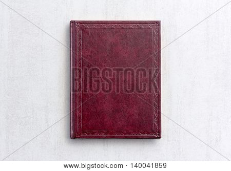 book dark purple color on gray background close-up top view