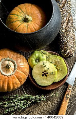 Pumpkin, a kitchen knife, thyme, green apples, bread