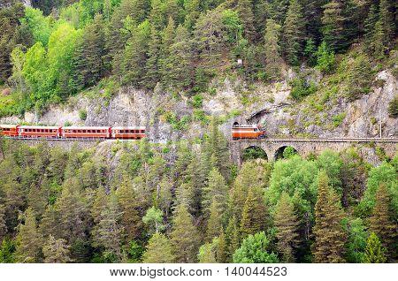 Passenger train goes through the tunnel. Switzerland.