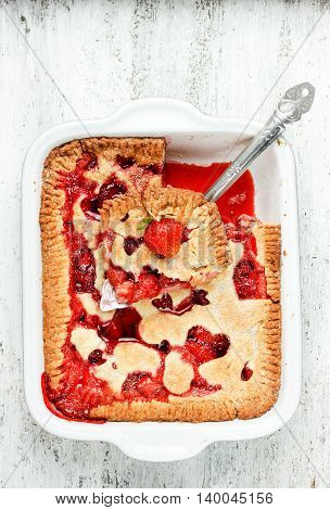 Strawberry pie on a white wooden table top view blank space for text