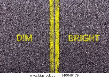 Tarmac With The Words Dim And Bright