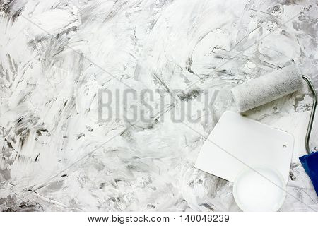 Process of making gray white marble background. Plaster and coloring the walls repairing the premises