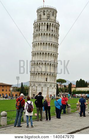PISA, ITALY - APRIL 29: Tourists visit leaning tower in Pisa, Italy on April 29, 2013. It is one of the main centers for medieval art and Unesco World Heritage