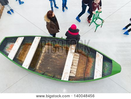 AMSTERDAM NETHERLANDS - DECEMBER 26 2015: old boat on a rink in amsterdam