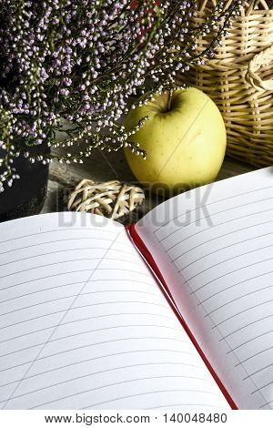 The notebook, the Apple, the flower Heather