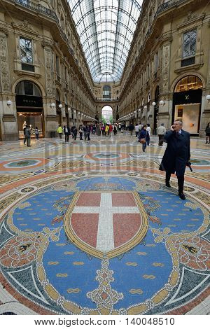 MILAN, ITALY - APRIL 30: Vittorio Emmanuele II shopping gallery on April 30, 2013 in Milan, Italy. Inaugurated in 1865, the gallery claims to be the oldest shopping center worldwide.