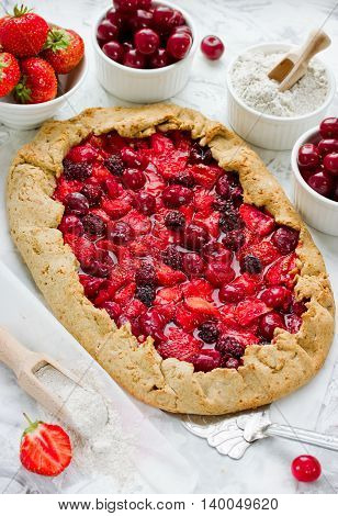 Dietary galeta from rye flour with strawberry cherry and blackberry. Summer berries pie. Crostata selective focus