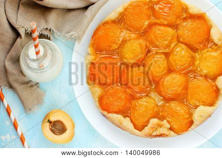 Homemade apricot tarte tatin with caramel top view
