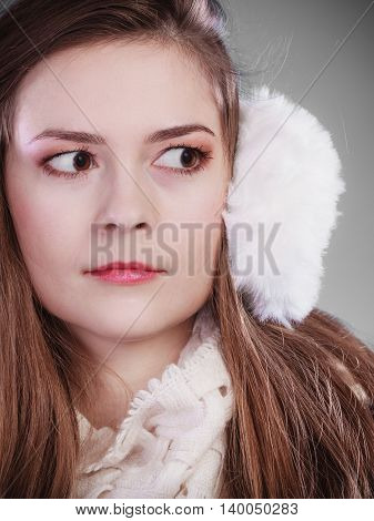 Teenage girl wearing fluffy white earmuff in winter fashion cold time.