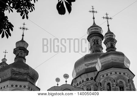 Golden tops and crosses of Christian Orthodox Abbey. Black&white photo