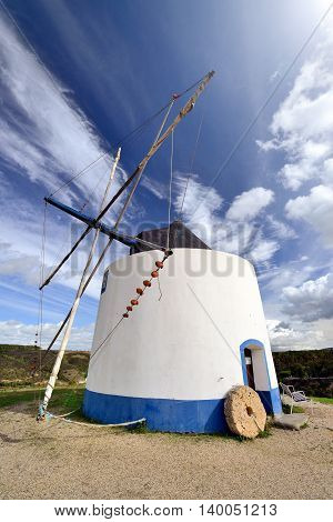 Old white windmill in Algarve, South Portugal
