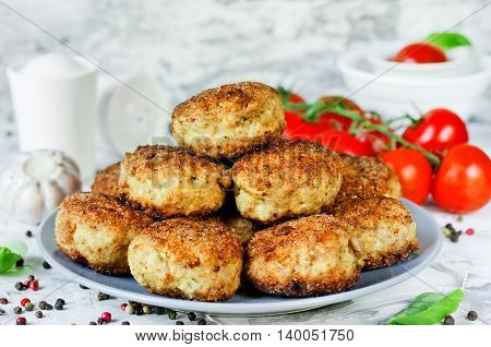 Delicious homemade cutlets with crispy crust of bread crumbs on dining table selective focus