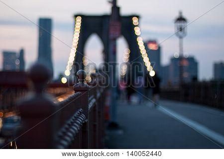 blurred view of New York Brooklyn Bridge at night
