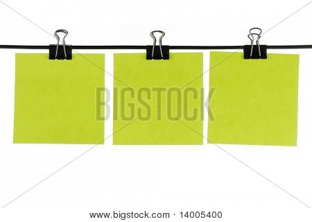 Blank green paper reminders on wire