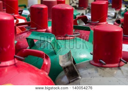 cooking gas containers closeup - group of gas bottles