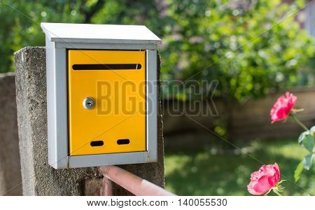 Yellow Mailbox In Front Of The House
