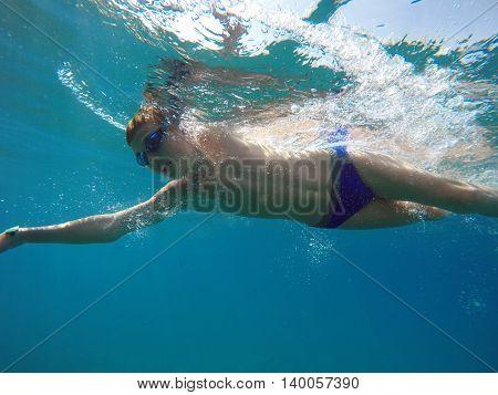 boy swim in the sea