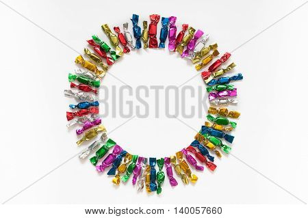 Candy Colored Wrappers On A White Background.