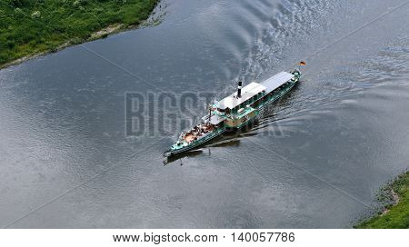 PIRNA, GERMANY - JUNE 20, 2016: The ship sails along the Elbe River top view