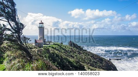 The lighthouse sitting atop the outermost point of Cape Disappointment Washington.