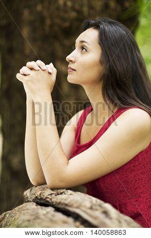 beautiful young woman hands praying in Outdoors