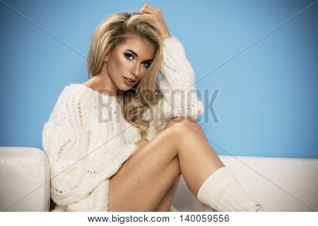 Adorable Sexy Shapely Blond Woman In Sweater Posing On Sofa