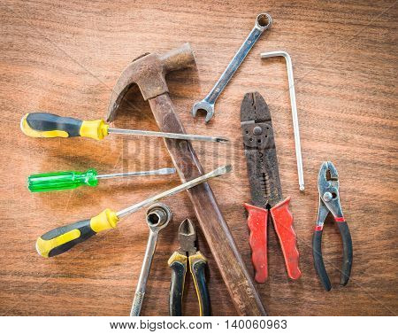 old & grunge set of hand tools many on wood floor background