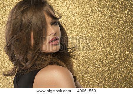 Magic Girl Portrait In Gold. Golden Makeup