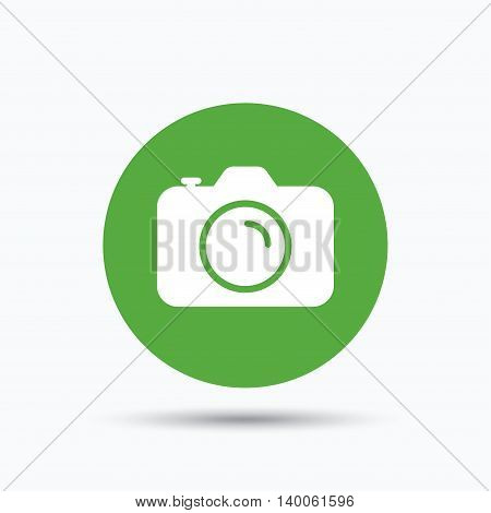 Camera icon. Professional photocamera symbol. Flat web button with icon on white background. Green round pressbutton with shadow. Vector
