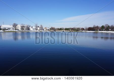 A view of a small man-made lake in a residential area of Joliet, Illinois during November.