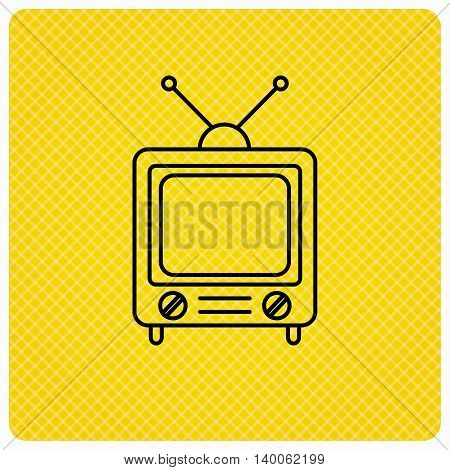 Retro tv icon. Television with antenna sign. Linear icon on orange background. Vector