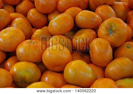Mandarin oranges piled for market close-up detail