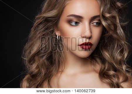 Beautiful Girl With Long Wavy Hair . Blonde With Curly Hairstyle
