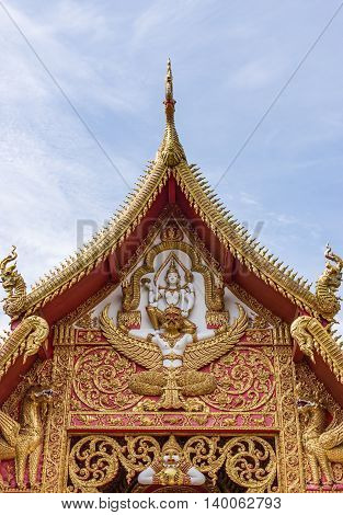 Golden gablel with the imaginary creature sculpture of the Thai church.(Public area not required Property Release)